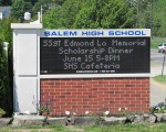 A posting of the memorial scholarship dinner on the Salem High School sign.